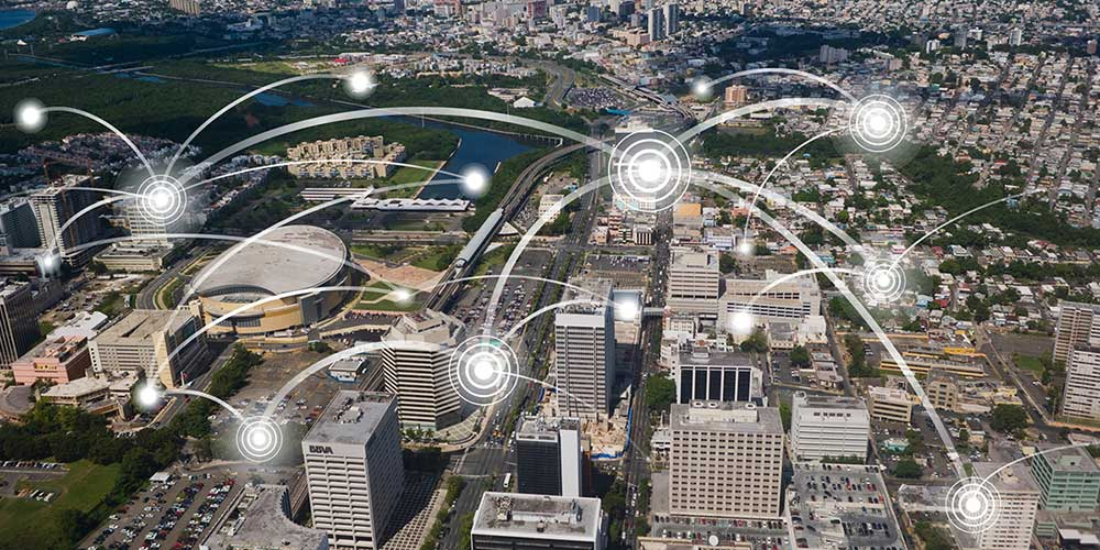 aerial view of Hato Rey with illustration to represent WAN system